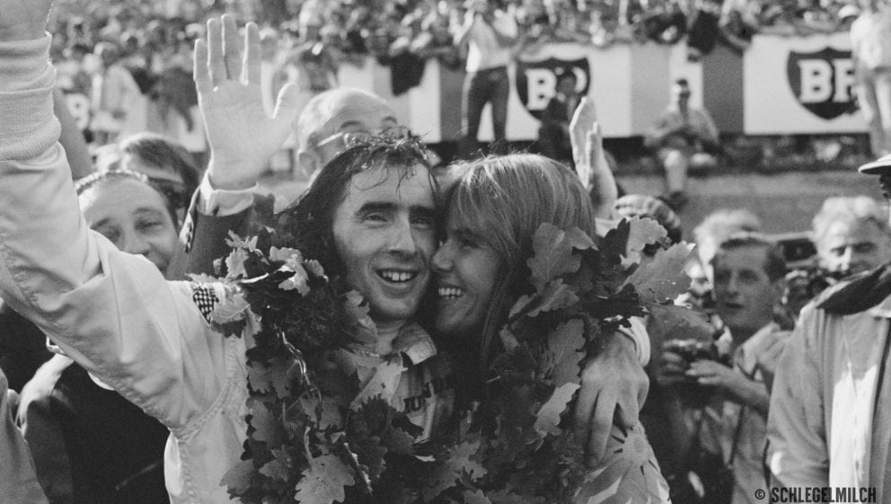 Jackie Stewart of Great Britain, driver of the #2 Matra International Matra MS80 Ford Cosworth DFV V8 celebrates with his wife Helen